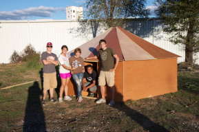 Students stand next to the Heaxyurt they built, a project they initiated for the Mathematical Thought course I am teaching. The hexayurt is a simple structure that takes geometry into disaster relief housing.